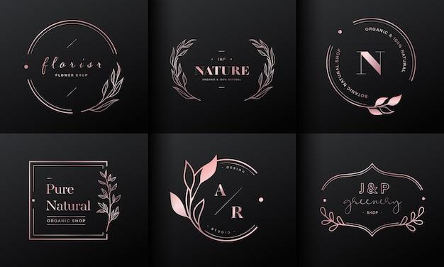 高級ロゴデザインコレクション。ブランドロゴ、コーポレートアイデンティティ、結婚式のモノグラムデザインのためのイニシャルと花の装飾が施されたローズゴールドのエンブレム。