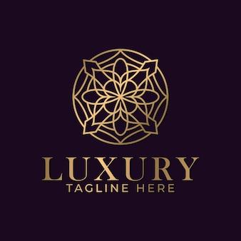 スパとマッサージビジネスのための豪華な曼荼羅と金色の装飾ロゴデザインテンプレート