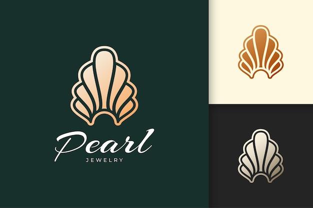 고급 진주 또는 조개 로고는 미용 관리 또는 화장품 브랜드에 적합한 보석 또는 보석을 나타냅니다.
