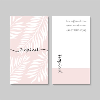 Luxury pink business card template with tropical leaves.