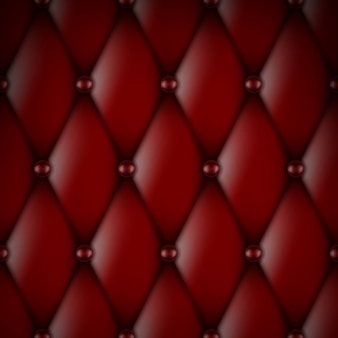 ボタンのシームレスなパターンを持つ豪華な赤い革張り