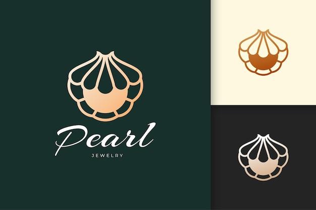 Роскошный логотип ракушки или моллюска с жемчужиной для ювелирных изделий или косметического бренда