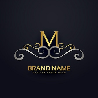 黄金の装飾品とmのロゴ