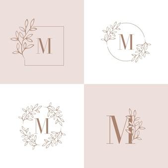 蘭の葉の要素を持つ文字mロゴデザイン