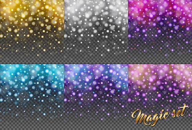 透明な背景に分離されたキラキラ粒子の魔法のセット。雨キラキラ粒子。フォーリングクリスマスシャイニング。雪片、降雪。きらめく質感。星のほこりが火花を散らします。