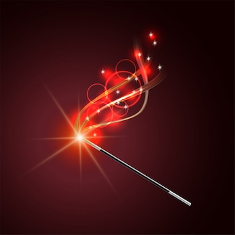 Magic wand with magical red sparkle trail