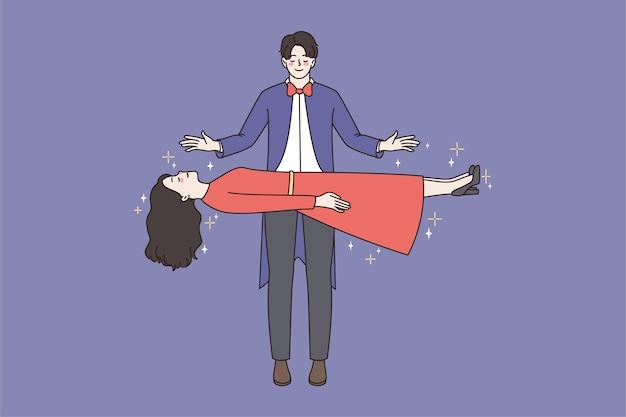 마술사는 서커스에서 여자를 공중에 뜨게합니다.