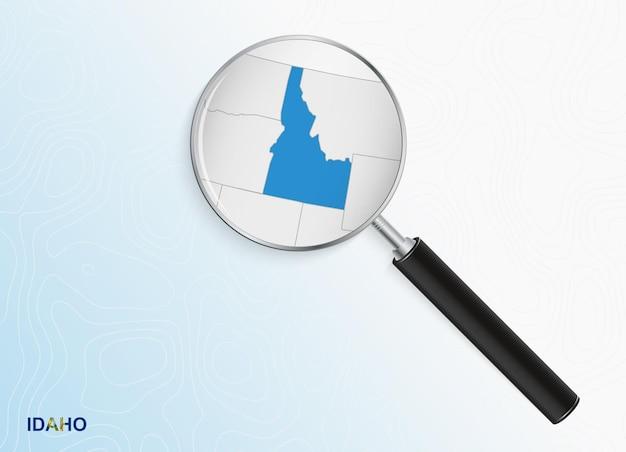 Лупа с картой айдахо на абстрактном топографическом фоне
