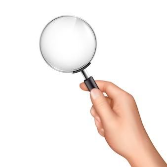 Magnifying glass in human hand