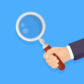 Magnifying glass, loupe in hand isolated on background. business man hold magnify
