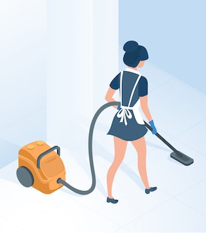 Maid in uniform vacuuming floor in hallway room