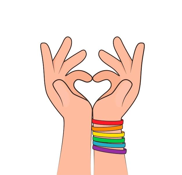손으로 하트 만들기. 손에 다채로운 lgbtq 팔찌. lgbt 프라이드 개념의 개념