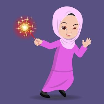 Malay girl playing firework during hari raya in traditional clothe