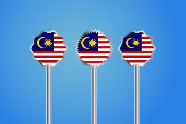シルバーのボーダーバッジとポールが付いたマレーシアの国旗