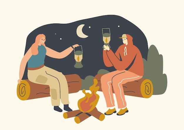 夜の丸太のキャンプファイヤーに座っている男性と女性のキャラクターは、内部に火のあるランタンを持っています。人々は照明、光源を使用します