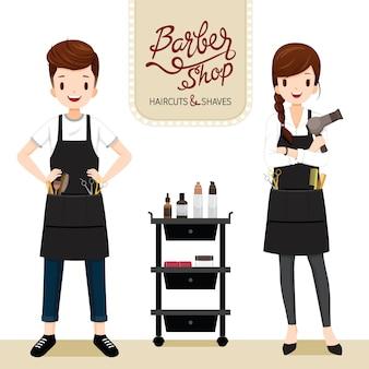 理髪店で理髪機器を持つ男性と女性の美容師