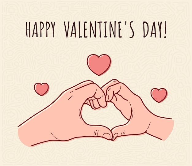 バレンタインデーの愛のシンボルを示す男性と女性の手