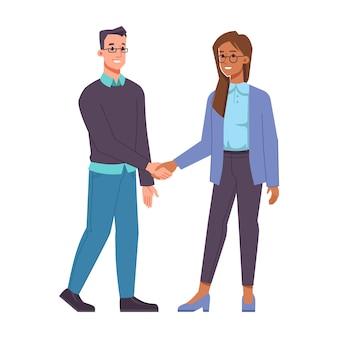 Мужчина и женщина разных рас, рукопожатие