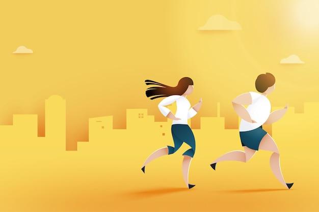 都市公園の小道を走る男性と女性