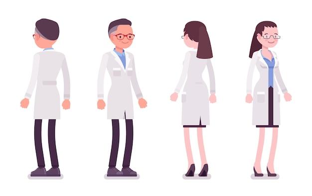 Мужской и женский ученый стоя