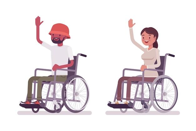 友人の挨拶と男性と女性の若い車椅子ユーザー