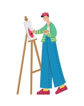 A male artist paints a picture on an easel. creative professions.