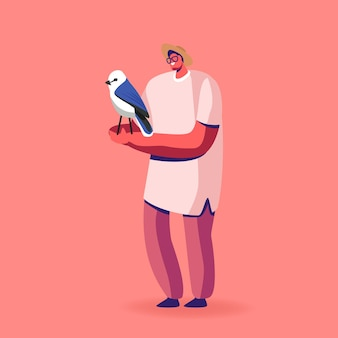 Male character bird owner or birdwatcher with wild pet sitting on hand