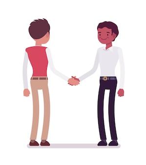 Male clerks handshaking