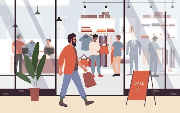 쇼핑몰 또는 부티크 옆에 걷는 쇼핑몰 젊은 힙 스터에서 남성 패션 판매