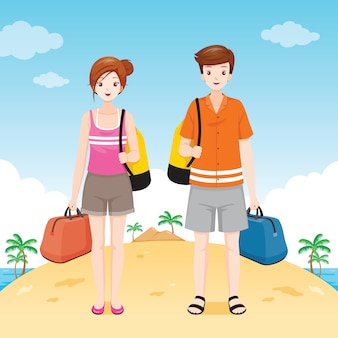 Male and female traveller with waterproof bag standing on the beach together