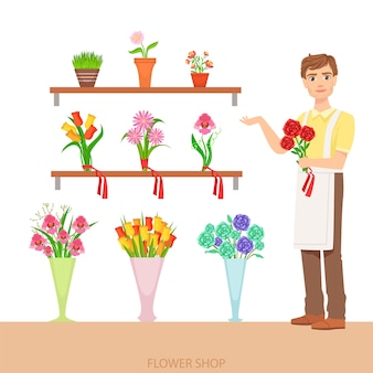 Мужской флорист в цветочном магазине, демонстрирующий ассортимент