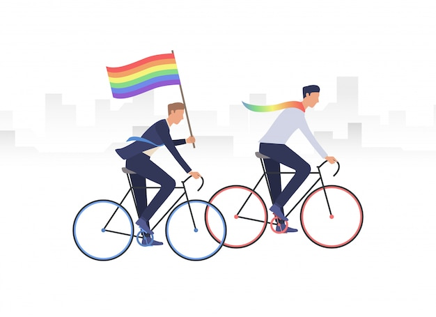 Male gay couple riding bikes