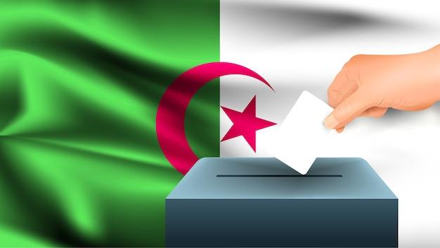 投票用紙を投じる男性の手
