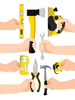 男性の手は、白、イラストで隔離される作業ツールを保持します。男の腕は楽器、ペンチ斧レベル定規スパナ、ジグソーを運ぶ。