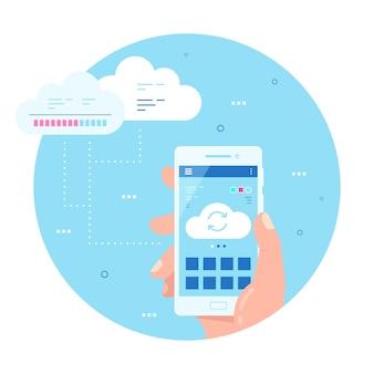 画面上のクラウド同期アイコンと携帯電話を持っている男性の手。スマートフォンを使用してファイルをアップロードまたはダウンロードします。クラウドデータストレージ、コンピューティングの概念。