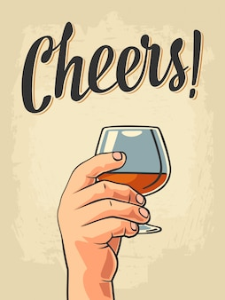 Male hand holding a glass of brandy. cheers toast lettering.