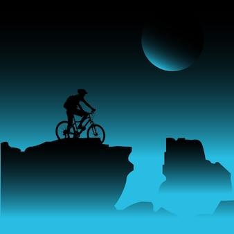 남성 산악 자전거 바위 위에 휴식을 취하십시오. 달과 함께 아름 다운 하늘