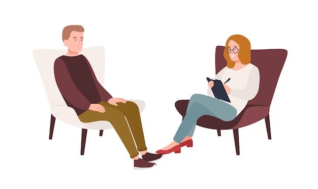 Пациент мужского пола в кресле и женщина-психолог, психоаналитик или психотерапевт, сидящие перед ним и разговаривающие