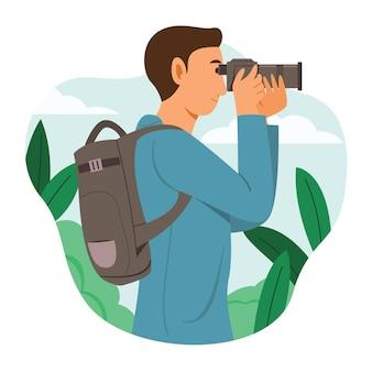 Фотограф-мужчина фотографирует природу