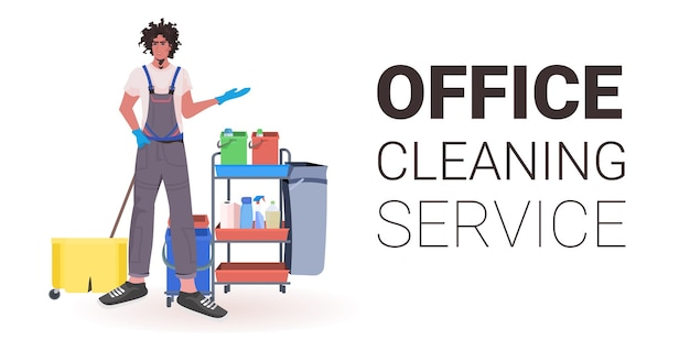 Male professional office cleaner man janitor in uniform with cleaning equipment copy space horizontal