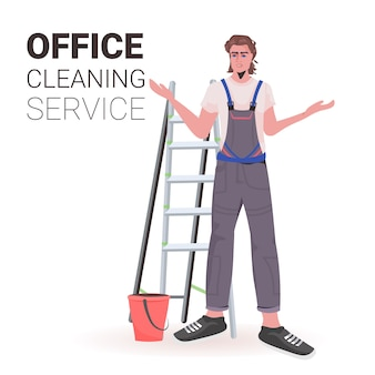 Male professional office cleaner man janitor in uniform with cleaning equipment copy space