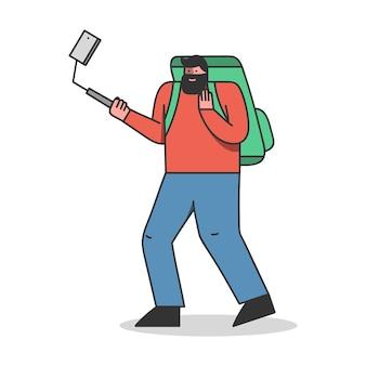 男性の旅行ブロガーが携帯電話でビデオを録画したり、ブログやチャンネルの写真を撮ったりする