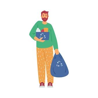 남성 자원 봉사자는 도시 공원이나 거리에서 쓰레기를 청소하기 위해 쓰레기 봉투를 들고 있습니다