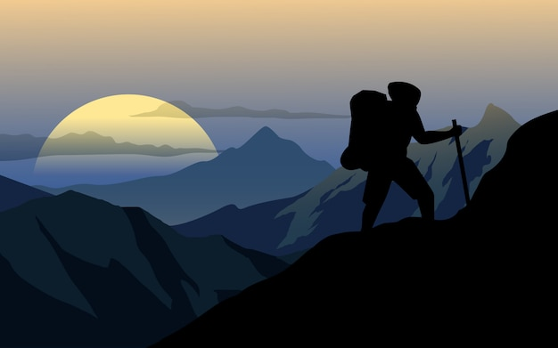 Man alone climbing up mountain in sunset