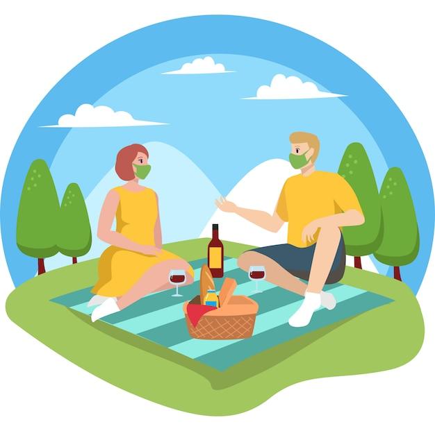 男と女は新しい通常の間に彼らのピクニックを楽しんでいます