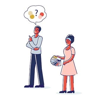 男性と女性は、サンプル付きのカラフルな見本帳から家のデザインや印刷の色を選択します。