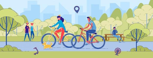 男と女のカップルが公園の道で自転車に乗る