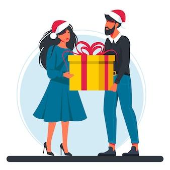 Мужчина и женщина, держащая большую подарочную коробку в шляпах санта-клауса. рождество и новый год. счастливые улыбающиеся мужчина и женщина несут большую подарочную коробку. бонус или специальное предложение. подарок. современные векторные иллюстрации.