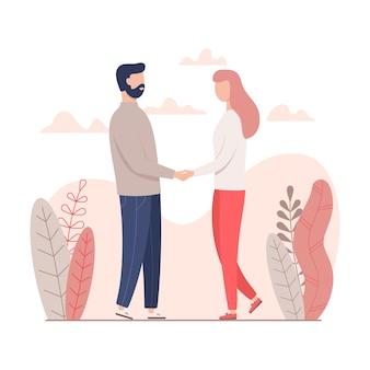 Мужчина и женщина, держась за руки на день святого валентина.