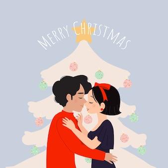 ピンクのクリスマスツリーの前でキスする男と女